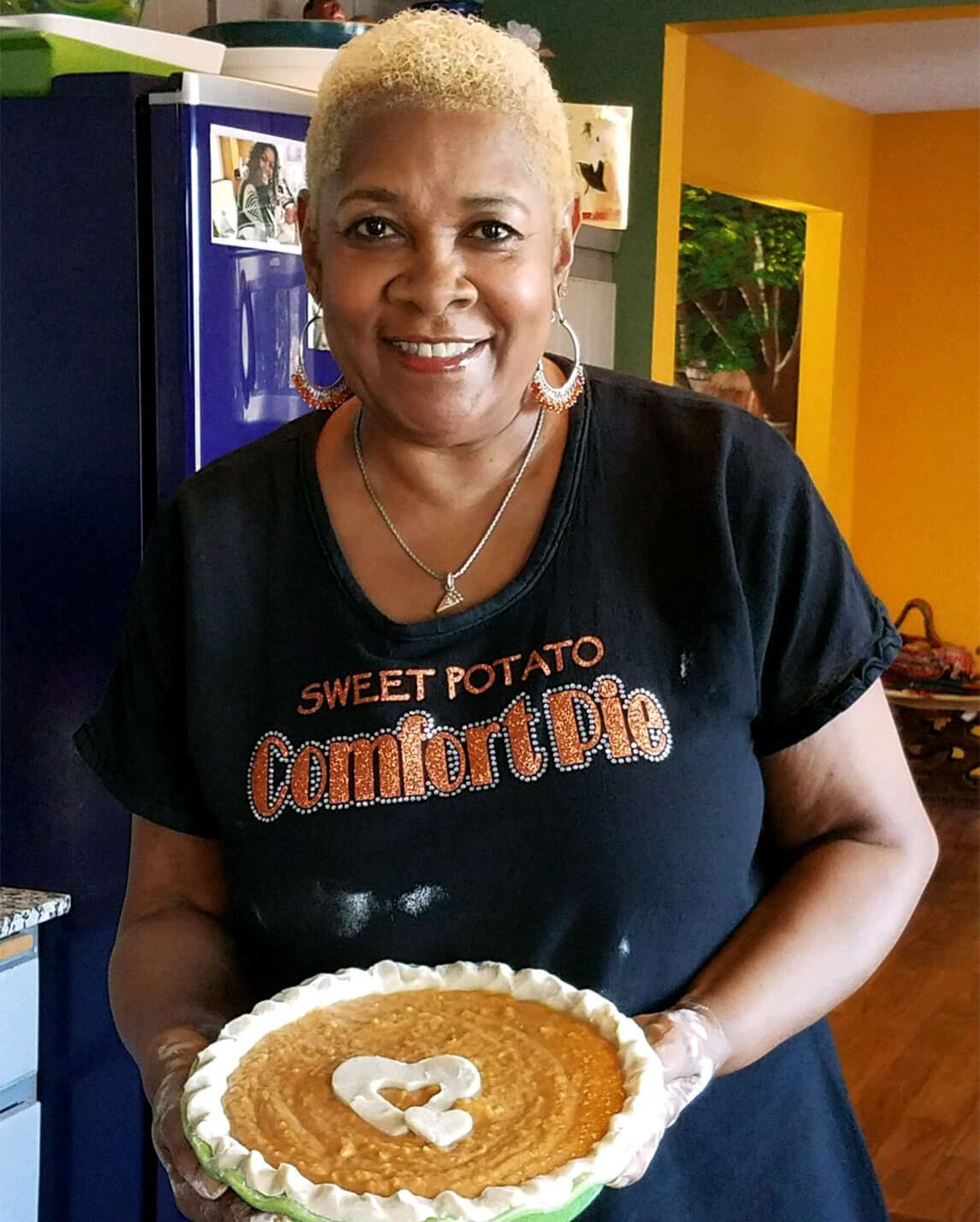 Rose holding a Sweet Potato Pie